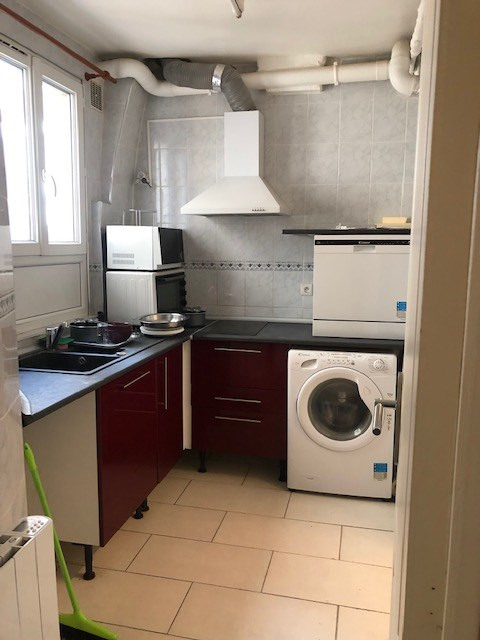 Location appartement Paris 10ème 1 100€ CC - Photo 4