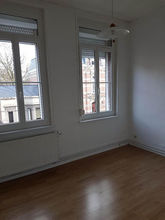Location maison / villa Caudry 553€ CC - Photo 5