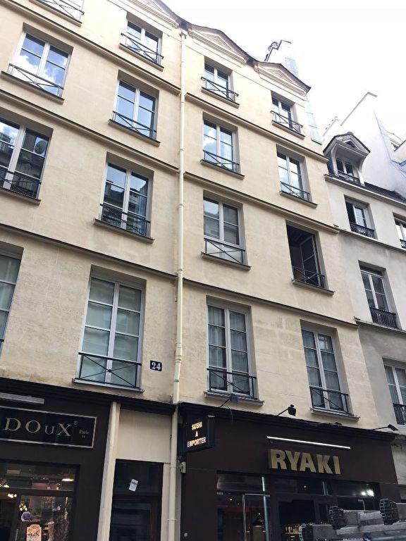 Location appartement Paris 4ème 1150€ CC - Photo 2