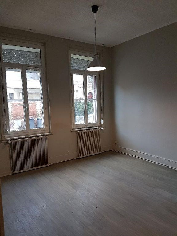 Location maison / villa Caudry 553€ CC - Photo 2