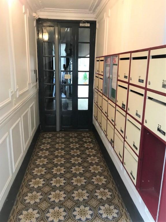 Location appartement Paris 17ème 990€ CC - Photo 10