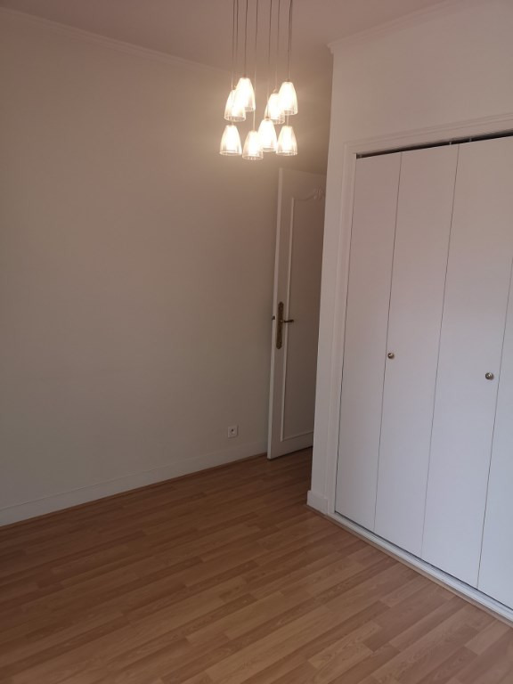Location appartement Paris 16ème 1 880€ CC - Photo 5