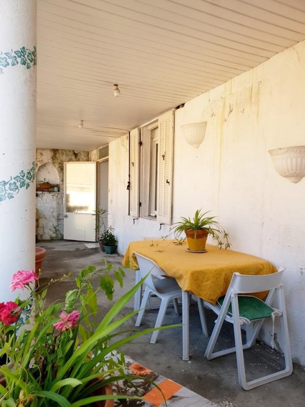 Appartement en rez-de-jardin à rénover