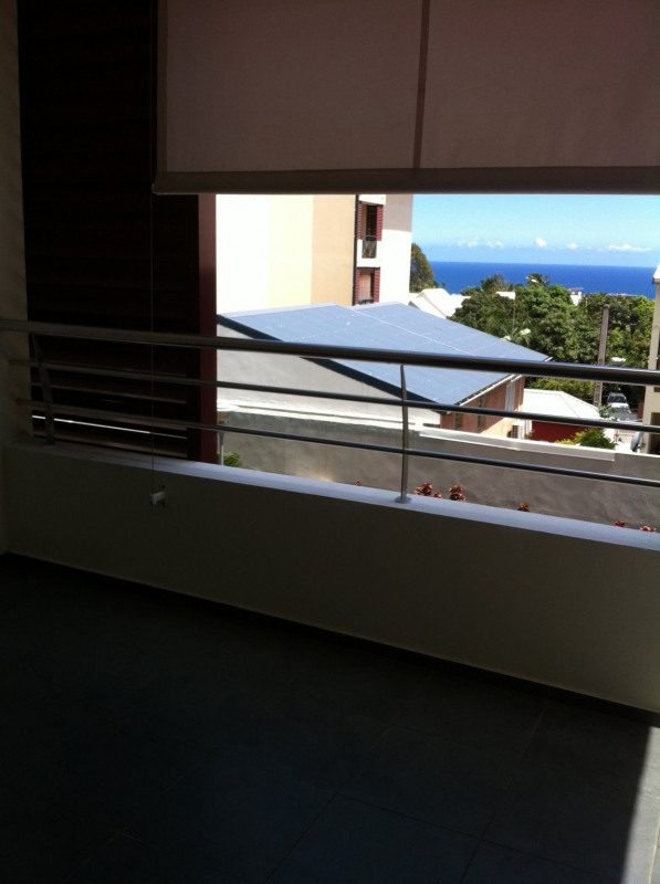 Location appartement Ste clotilde 718€ CC - Photo 5