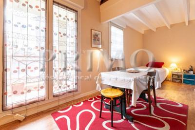 Studio mezzanine de 32 m² - balcon - cave - parking sous-sol