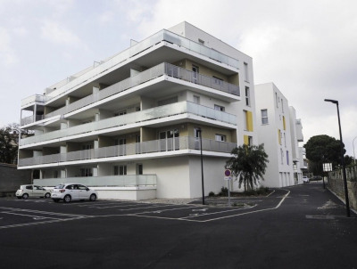 Appartement T2 avec balcon et place de parking privative - R
