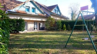 Maison jumelée avec jardin