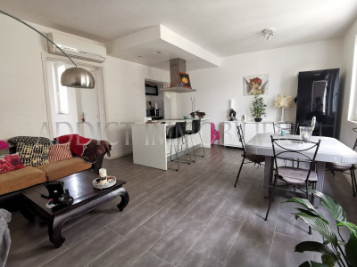 Immeuble: appartement + local commercial