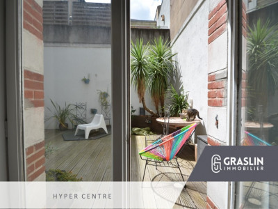 T2 bis esprit loft centre ville avec patio privatif et asc
