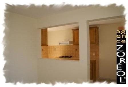 Location appartement Petite ile 600€ CC - Photo 2