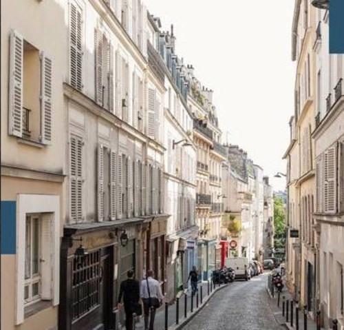 Vente de prestige appartement Paris 18ème 1140000€ - Photo 10