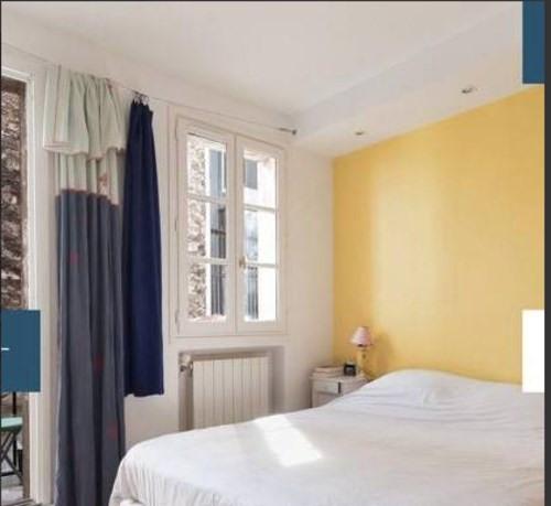Vente de prestige appartement Paris 18ème 1140000€ - Photo 5