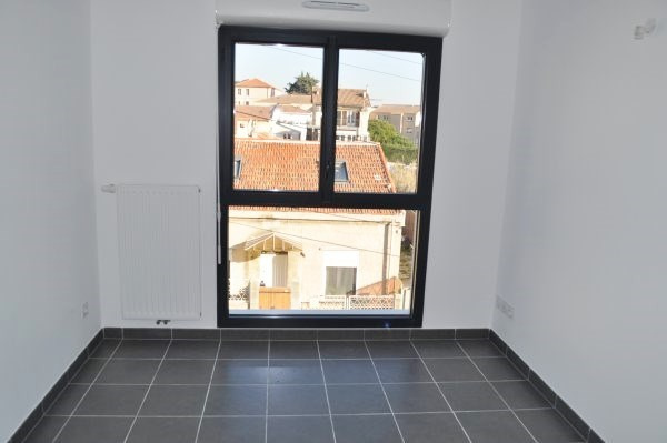 Location appartement Marseille 16ème 710€ CC - Photo 5