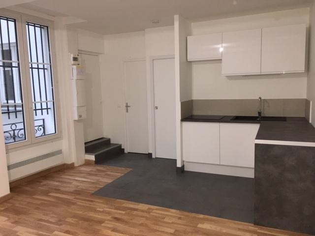 Location appartement Paris 2ème 1 272€ CC - Photo 1