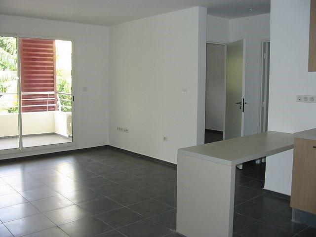 Location appartement Ste clotilde 602€ CC - Photo 1