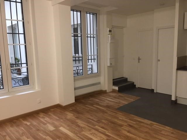 Location appartement Paris 2ème 1 272€ CC - Photo 4