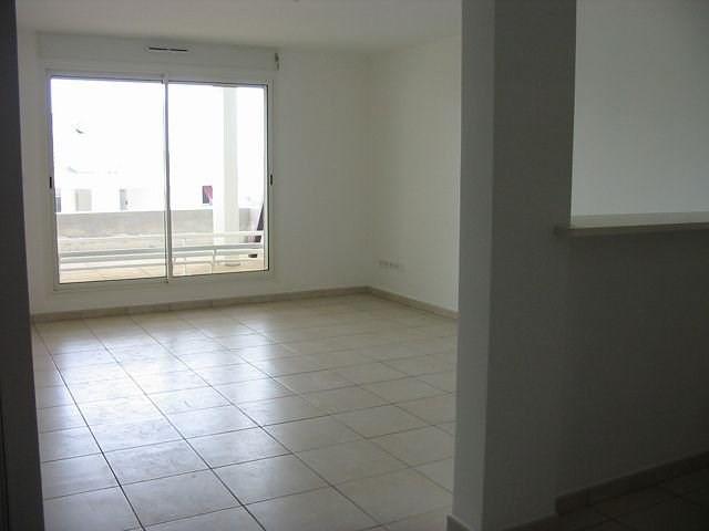 Location appartement Ste clotilde 606€ CC - Photo 2