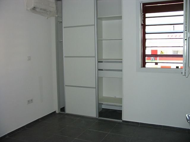 Location appartement Ste clotilde 748€ CC - Photo 5