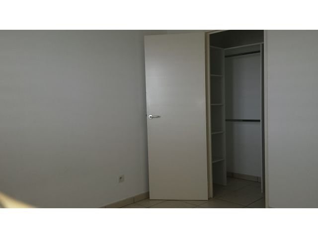Location appartement Ste clotilde 768€ CC - Photo 7