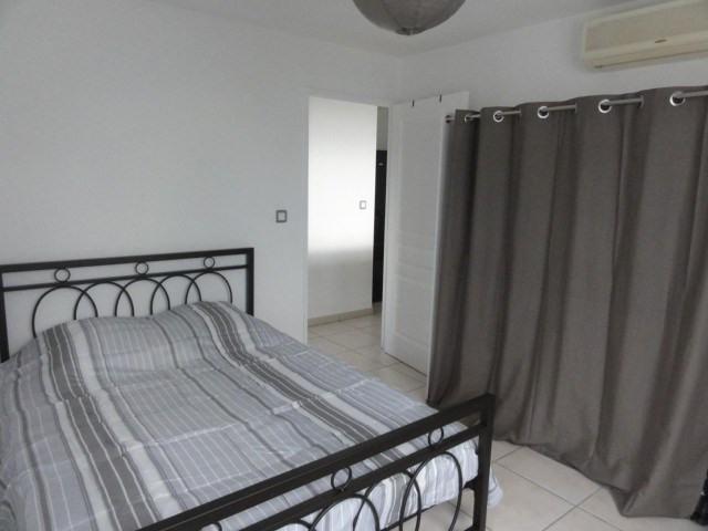 Location appartement La possession 720€ CC - Photo 11