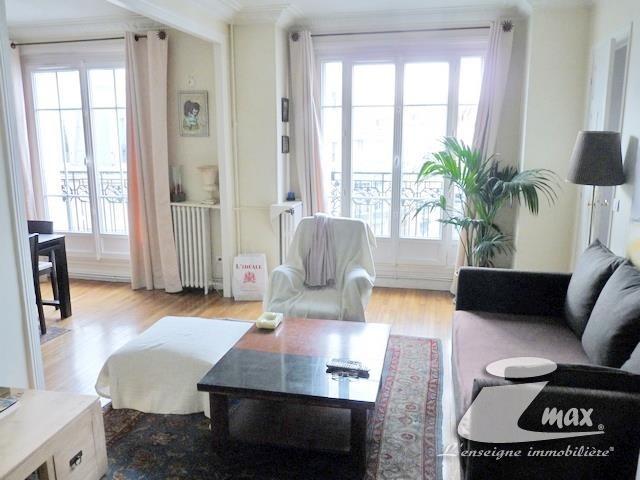 Vente appartement Paris 18ème 676000€ - Photo 2