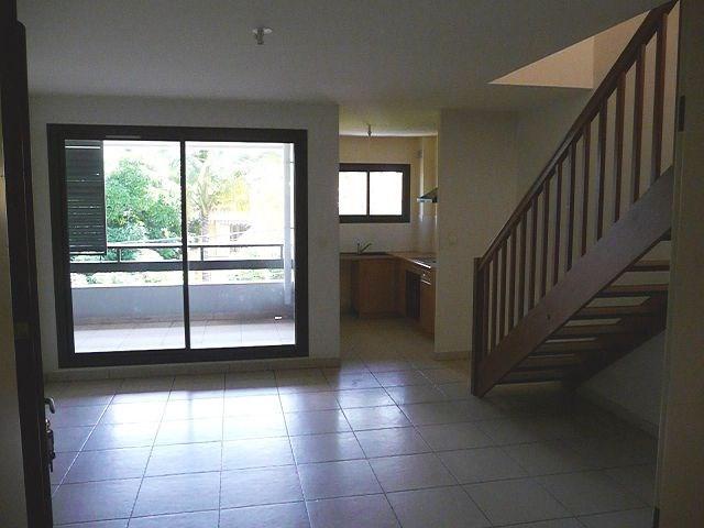 Location appartement La possession 752€ CC - Photo 1