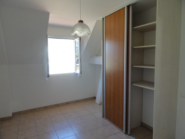 Location appartement St denis 1 200€ CC - Photo 4
