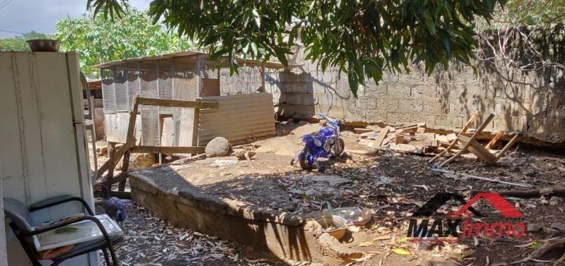Terrain + maison a démolir