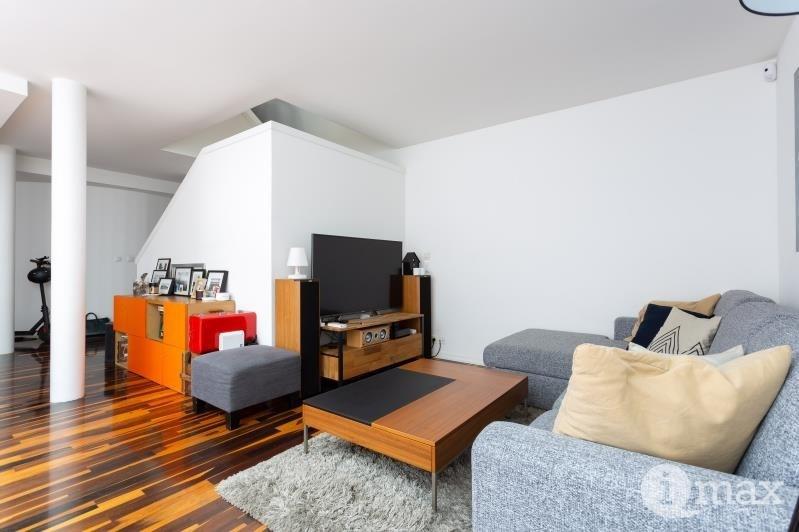 Vente de prestige appartement Paris 18ème 1070000€ - Photo 3