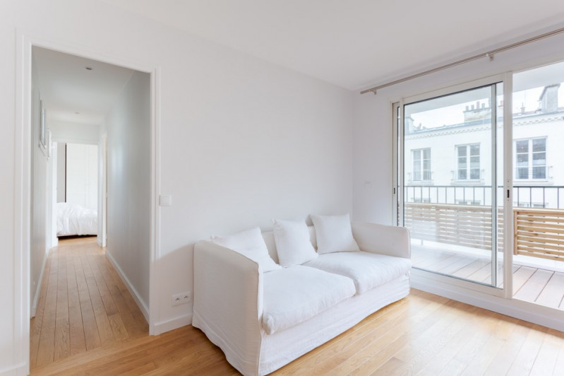 Vente de prestige appartement Paris 18ème 1030000€ - Photo 5