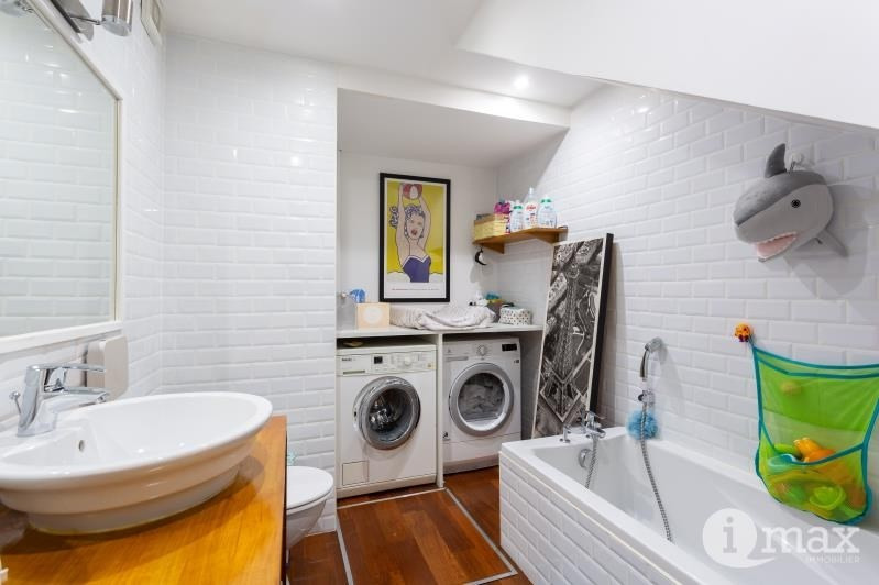 Vente de prestige appartement Paris 18ème 1070000€ - Photo 8