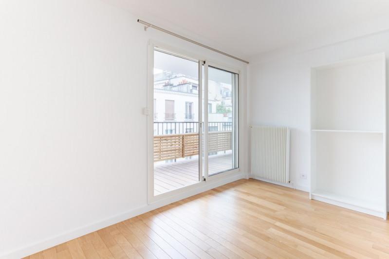 Vente de prestige appartement Paris 18ème 1030000€ - Photo 7
