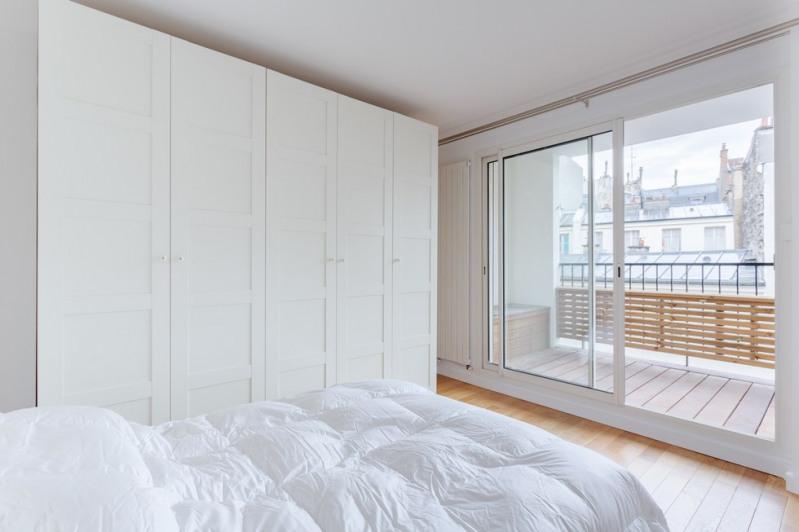 Vente de prestige appartement Paris 18ème 1030000€ - Photo 6