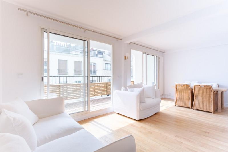 Vente de prestige appartement Paris 18ème 1030000€ - Photo 2