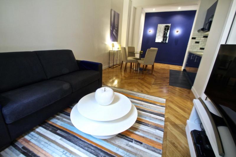 Location appartement Paris 18ème 1580€ CC - Photo 4