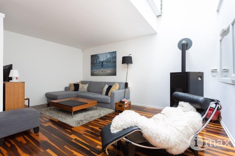Vente de prestige appartement Paris 18ème 1070000€ - Photo 2