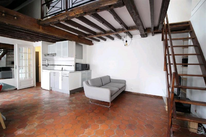 Rental apartment Paris 4ème 1580€ CC - Picture 1