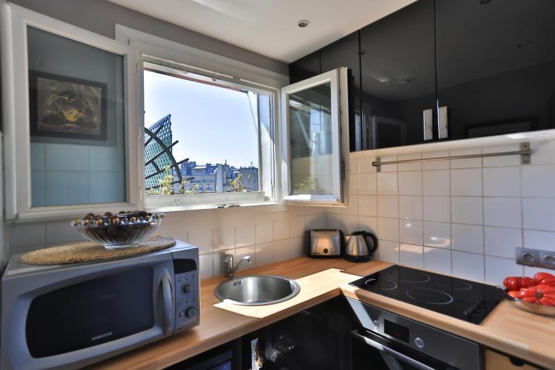 Vente de prestige appartement Paris 16ème 1180000€ - Photo 10