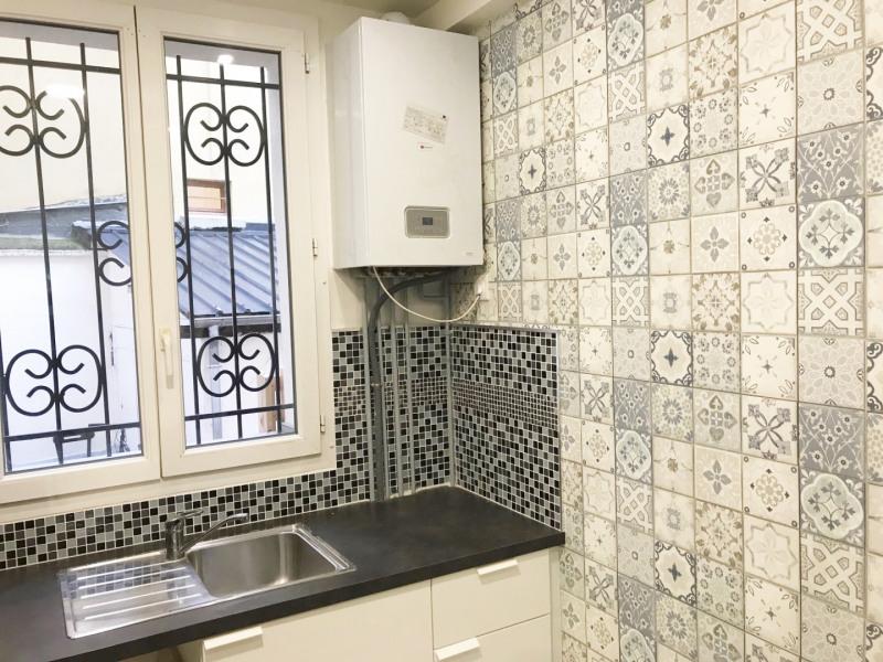 Vente appartement Paris 18ème 294000€ - Photo 2