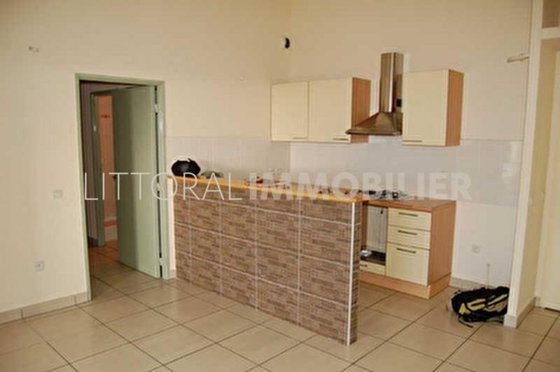 Location appartement La possession 668€ CC - Photo 1