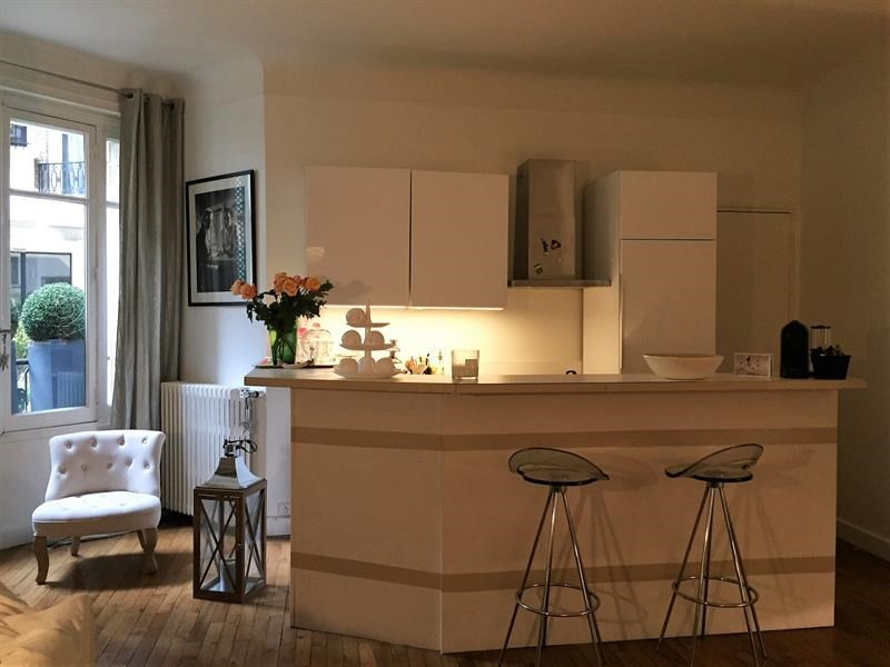 Location appartement Paris 16ème 2 150€ CC - Photo 2