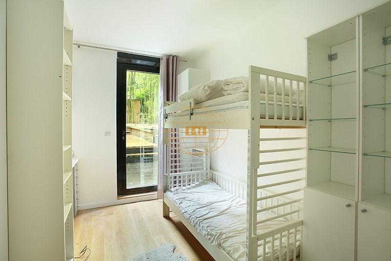 Vente de prestige appartement Paris 19ème 770000€ - Photo 8