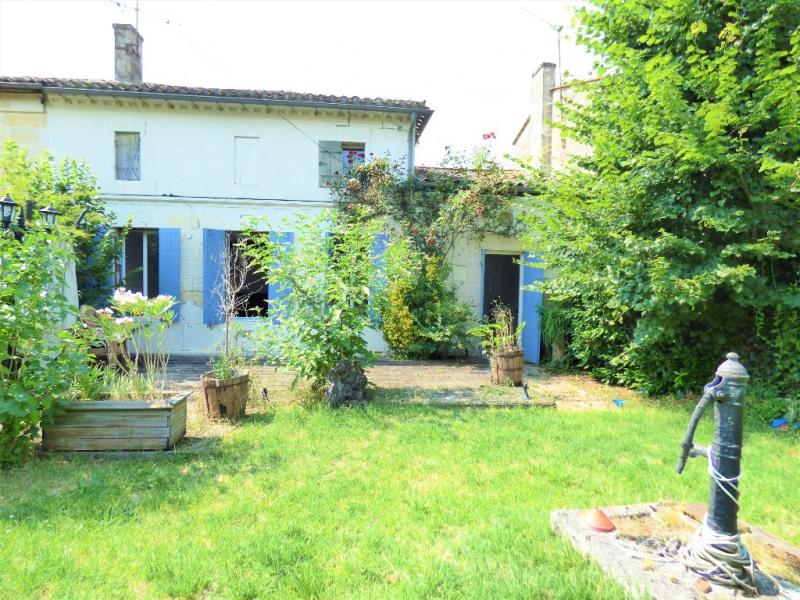 Maison en pierre mitoyenne sur 362 m² de jardin