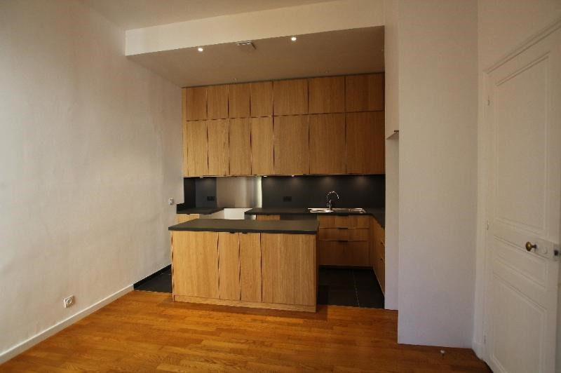 Location appartement Paris 7ème 4 570€ CC - Photo 5