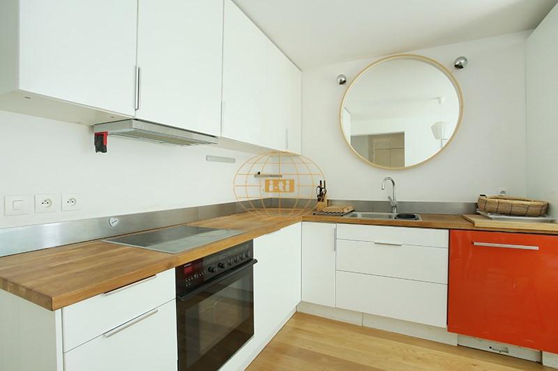 Vente de prestige appartement Paris 19ème 770000€ - Photo 7