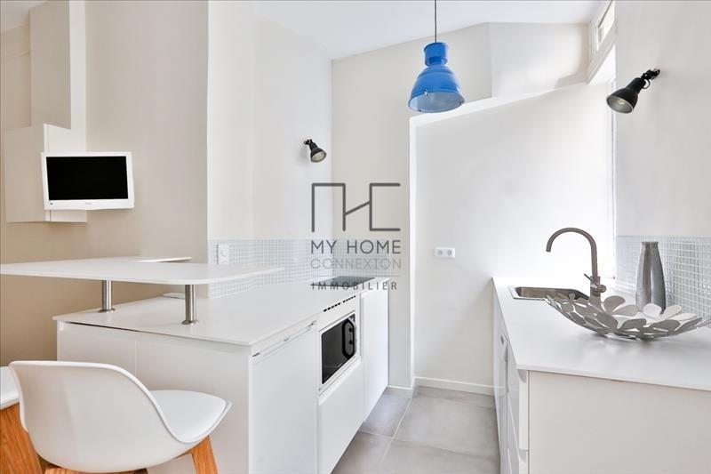 Vente appartement Paris 4ème 526000€ - Photo 3