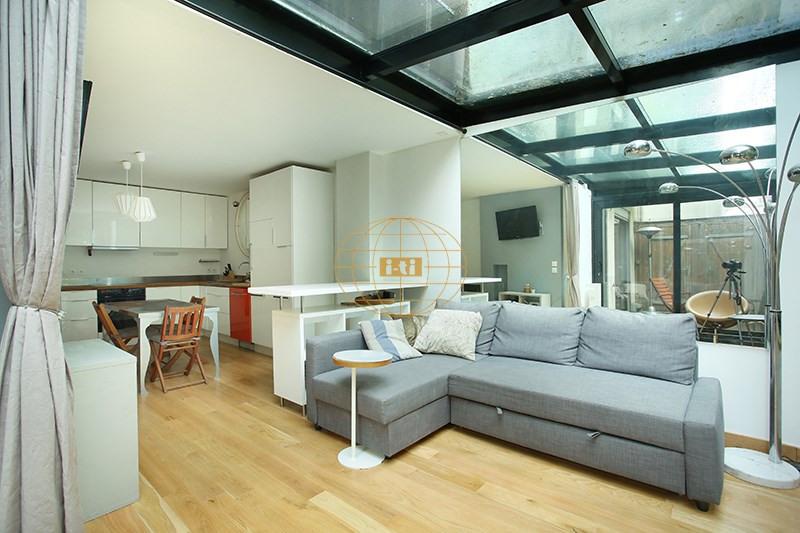 Vente de prestige appartement Paris 19ème 770000€ - Photo 2