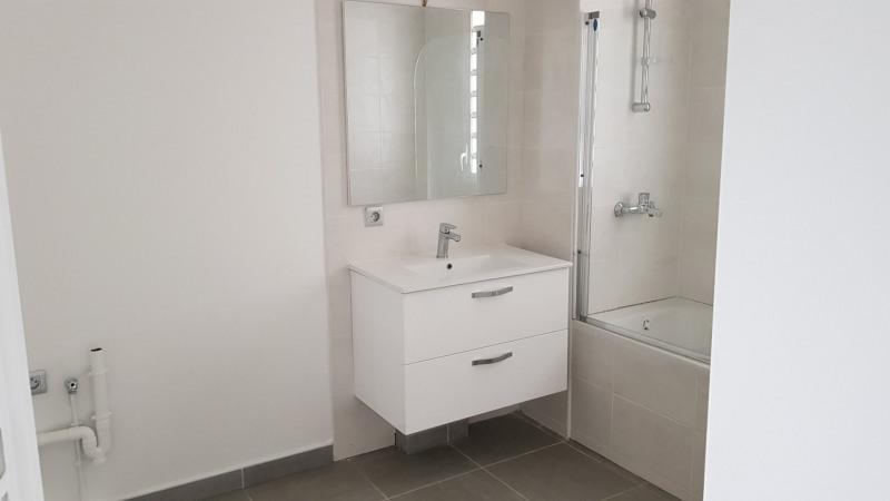 Location appartement St denis camelias 651€ CC - Photo 6