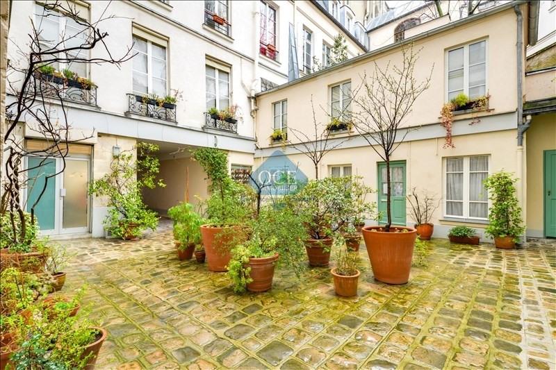 Sale office Paris 3ème 890000€ - Picture 3