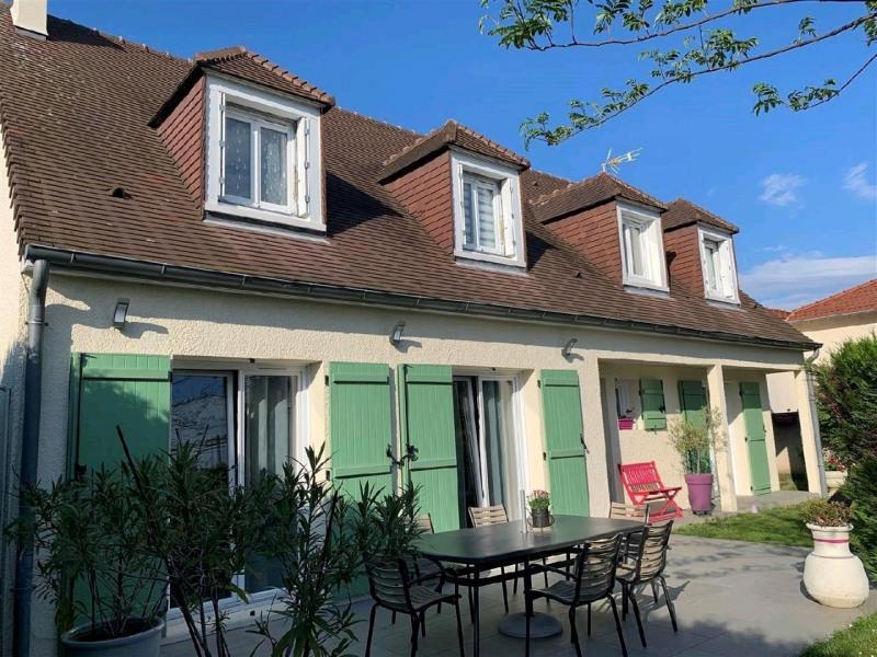 Sale house / villa Taverny 509600€ - Picture 1
